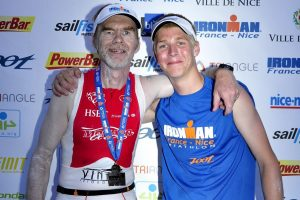 2009: Nice Ironman - Chris hands me my Finisher's Medal
